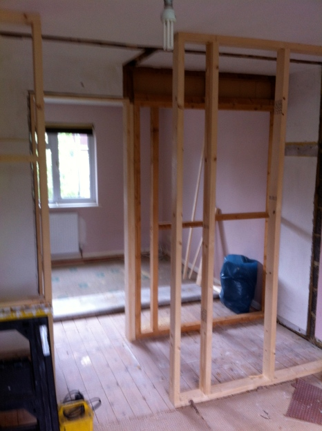 Construct stud walls in cupboard space & install en-suite bathroom