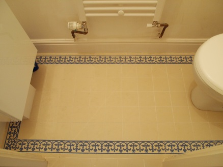 Ornate floor tiling in downstairs WC